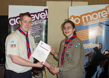 An Explorer Scout from the 3rd EK getting her certificate